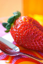 Strawberry and spoon Royalty Free Stock Photo