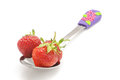 Strawberry in the spoon isolated on the white background red strawberries Stock Photos