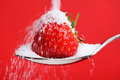 Strawberry on spoon with sugar Royalty Free Stock Photo