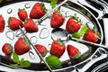 Strawberry still life of fruit with flatwares on metal plate Royalty Free Stock Images