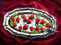 Strawberry still life of fruit on metal plate on cloth background Royalty Free Stock Image