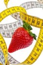 Strawberry and tape measure for a successful diet Royalty Free Stock Photo