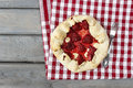 Strawberry tart on checked red and white table cloth Royalty Free Stock Photo