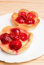 Strawberry tarts two on a white plate Stock Images