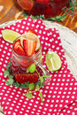 Strawberry tea glass mug with infuser and fresh berry fruit Royalty Free Stock Photos