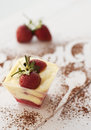 Strawberry tiramisu glass of on wooden table Stock Photo