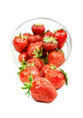 Strawberry trickling through the transparent plate isolated Stock Image