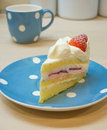 Strawberry vanilla cream cake on the polka dot plate Stock Photos