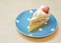 Strawberry vanilla cream cake on the polka dot plate Stock Image