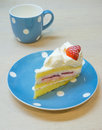 Strawberry vanilla cream cake on the polka dot plate Royalty Free Stock Photos