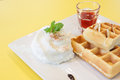 Strawberry Waffle whipped Cream on yellow desk Royalty Free Stock Photo