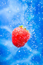 Strawberry in a water splash Royalty Free Stock Photos