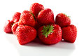 Strawberry on white reflexive background ripe isolated Royalty Free Stock Photo