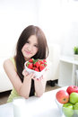 Strawberry woman showing fresh strawberries at home asian beauty Stock Images