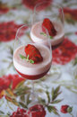 Strawberry and yoghurt jelly with fresh strawberry in glass delicious desert from light some leaves of mint Stock Image