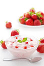 Strawberry yogurt in a bowl with strawberries Stock Photos