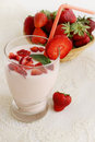 Strawberry yogurt with fruit pieces the morning breakfast Royalty Free Stock Images