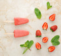 Strawberry yogurt ice cream popsicles with mint over marble tray Royalty Free Stock Photo