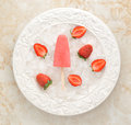 Strawberry yogurt ice cream popsicles with strawberry over ice c Royalty Free Stock Photo