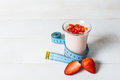 Strawberry yogurt smoothie with measure tape Royalty Free Stock Photo