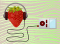 Strawbery listening music player Royalty Free Stock Image