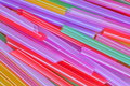 Straws colored water Royalty Free Stock Photo