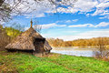 Straws hut near lake spring landscape with forest blue sky and small Stock Photo