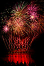Streaks of red fireworks with people watching by a lake Royalty Free Stock Photos
