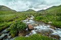Stream in blurred motion tien shan kyrgyzstan Stock Photos