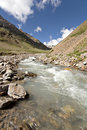 Stream of mountain river. Caucasus valley. Stock Photos