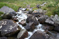 Stream of mountain river among stones and boulder Royalty Free Stock Photos