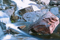 Stream rushing over boulders Stock Images