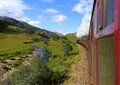 Stream train jacobite glenfinnan viaduct scotland uk Royalty Free Stock Image