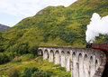 Stream train jacobite glenfinnan viaduct scotland uk Stock Image