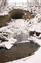 Stream water flow arch waterfall ice frozen winter Royalty Free Stock Photography
