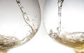 Stream of wine being pouring into a two glasses closeup wine splash splashing Stock Images