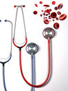 Streaming blood cells and medical stethoscope Royalty Free Stock Photography