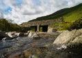 Streams run under a bridge kirkstone pass cumbria shot of stream near the slate mines the lake district Royalty Free Stock Image