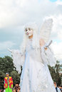 Street actor woman dressed like an angel poses for photos in Moscow Royalty Free Stock Photo