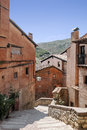 Street of albarracin located in the spanish province teruel you can see the medieval houses and the mountain in the background Stock Photo
