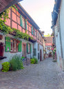 Street in alsace france on a sunny day there are shops and pots are on the it is a editorial picture september image Stock Photos
