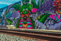 Street art dragon of sacramento displaying along rail line Royalty Free Stock Images