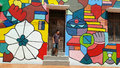 Street art in melaka man standing at with wall painting background at malacca Stock Photography