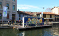 Street art on navigli at fuorisalone design week of milano during salone del mobile Stock Photos