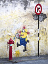Street art painting of minion in georgetown penang malaysia from popular animation movie despicable me george town Royalty Free Stock Photography