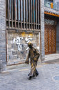 Street art performers walk on the road in china sichuan chengdu broad and narrow alley Royalty Free Stock Photos