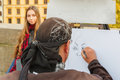Street artist paints a beautiful girl in Prague Royalty Free Stock Photo
