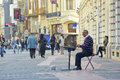 Street artist playing the cymbalon downtown bucharest romania september unidentified busker plays cimbalom and receives money Royalty Free Stock Image