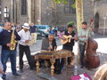 Street artists musicians near the cathedral of colmar alsace france Royalty Free Stock Image
