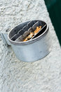 Metal ashtray on a wall full with cigarette old retro style not cleaned Royalty Free Stock Photo
